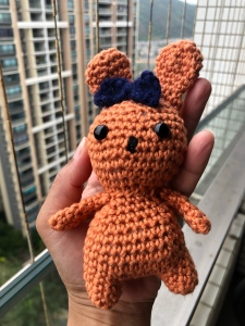Peach colored crochet rabbit with bow