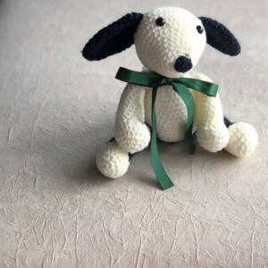 Crochet puppy dog with green ribbon